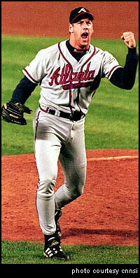 Atlanta Braves pitcher John Rocker raises a defient fist to the crowd.